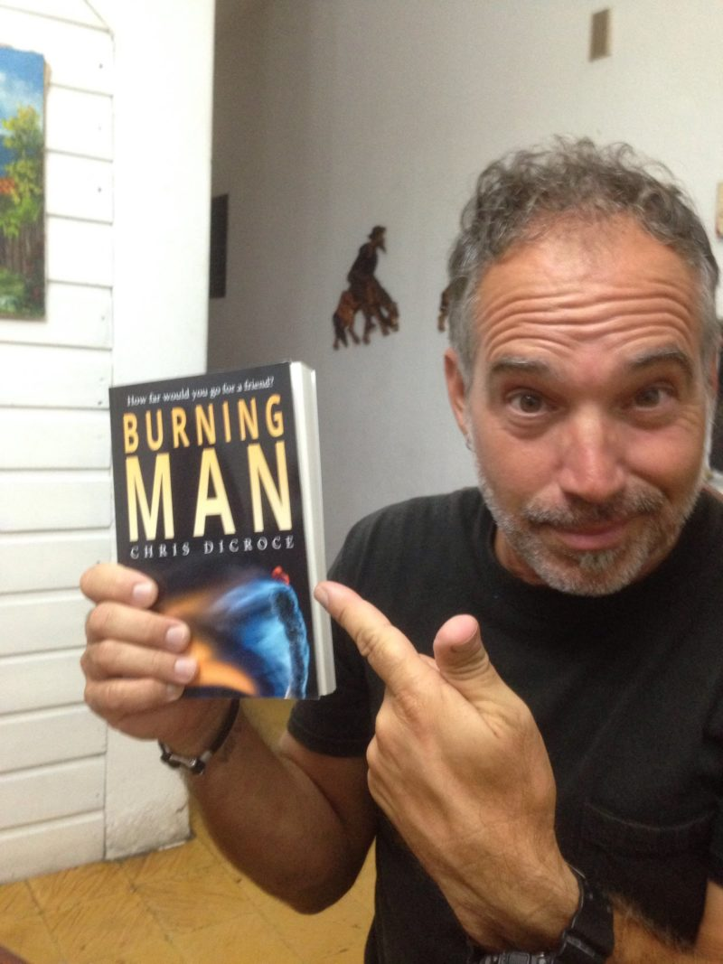 Chris and his first print copy of Burning Man